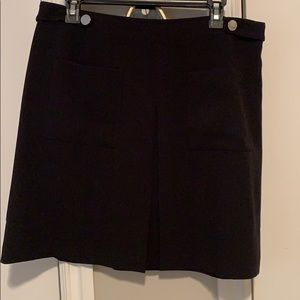 Black skirt with front pockets.